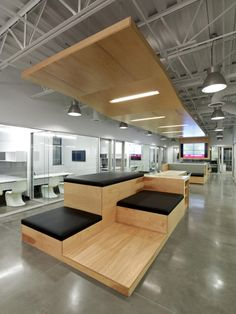 Inside Alterras HQ. Custom millwork seating for collaborative space.