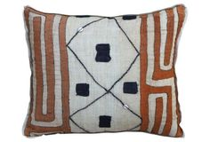 You can't go wrong with vintage Kuba cloth pillows on your sofa.