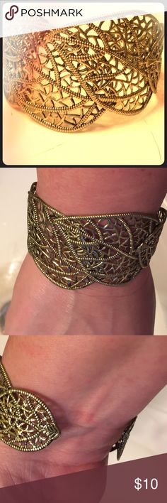 Gold Filigree Leaf Cuff Bracelet Lovely gold filigree cuff bracelet. Light weight and adjustable to virtually any size wrist. Could go with anything!!! Jewelry Bracelets