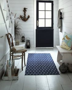 Anchors Aweigh: 23 Unique Finds For Summer Decorating: A deep navy blue creates the perfect backdrop for the Garnet Hill Printed Cotton Rug ($48).