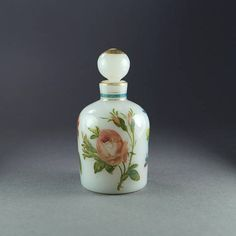 A divinely small French opaline scent bottle form the Napoleon III period, circa 1860. This dinky perfume bottle depicts beautifully painted flowers complete with buttery rich gilding. It is oh so pretty, we feel sure that it will delight. Please note that the stand is for display
