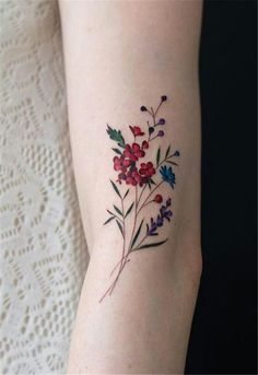 Today, millions of people have tattoos. From different cultures to pop culture enthusiasts, many people have one or several tattoos on their bodies. While a lot of other people have shunned tattoos… Flower Bouquet Tattoo, Delicate Flower Tattoo, Colorful Flower Tattoo, Small Flower Tattoos, Flower Tattoo Arm, Flower Tattoo Designs, Small Tattoos, Little Tattoos, Mini Tattoos