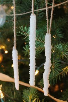 I love this SUPER simple tutorial for Borax crystal icicle ornaments! It uses just 2 ingredients, has few steps, and they aren't fragile at all. The best part - it's WAY cheaper than store-bought and they're a fun experiment to try with the kids! http://www.amandakatherine.com/diy-icicle-ornaments/