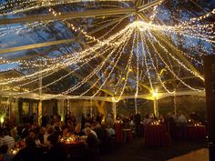 Clear Tent Twinkie Chandelier by theeventproducer, via Flickr  I love this clear tent with lights