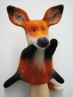 Picture tutorial of making a wet felted hand puppet
