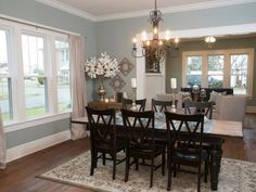 The French doors were removed to open the dining room up to the living room, creating an open concept feel. The dining room has been repainted a light, modern blue. The original wood floors have been refinished in a rich, warm tone.