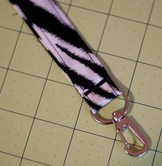 lanyard tutorial - simple and easy, one long strip buy any material you want doesn't have to be zebra and a