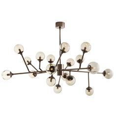 """Dallas Chandelier by Arteriors  Mid-century inspiration results in this 18 light, brown nickel take on Sputnik. 12 adjustable arms. Photographed with 2"""" tubular bulbs."""