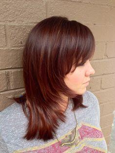 Layered women's hair cut on medium length hair