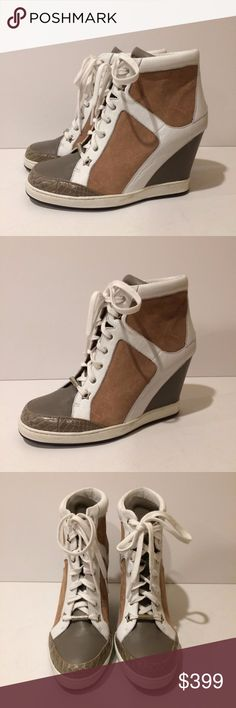 "New! Jimmy Choo Panama Leather High Top Sneaker New Store Display Jimmy Choo Panama Suede Leather Wedge High Top Sneakers. Retail $795.00. Size: 40.5EU. Heel Height: 4.25"" wedge heel. Color: Multi. Suede upper with tonal patent leather panels. Almond toe. Lace-up front with star-shape grommets. Suede/Leather upper. Padded leather insole. Leather lining. Rubber sole. Made in Italy. Condition: New store display shoes with minor exterior marks/light stains/ink dots on brand label. Box and dust…"