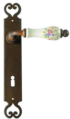 classic iron lever handle with porcelain aveilable in 13 different finishes and return spring on request. (Rust as shown ) Maniglia Classica in ferro con porcellana disponibile in 13 diverse finiture e a richiesta molla di ritorno ( finitura ruggine rappresentata )