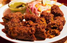 Mutton Seekh Kebab Recipe is made from ground spiced goat meat which is minced and molded onto the skewers and cooked over tandoor or on hot tawa.