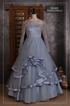 Designer lehanga by sashivangapalliBrides you have one stop destination for all your bridal needs !!Beautiful ice blue color layered floor length gown.For Enquiry: 9000777796Email :Kmythreya@gmail.com. 21 May 2018 Gown Party Wear, Party Wear Indian Dresses, Designer Party Wear Dresses, Indian Gowns Dresses, Designer Wedding Gowns, Indian Fashion Dresses, Indian Designer Outfits, Designer Gowns, Designer Lehanga