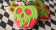 Mirror mirror on the wall, these might be the fairest cookies of them all. For halloween, try these poison apple sugar cookies. recipes for halloween Halloween Desserts, Postres Halloween, Halloween Cookie Recipes, Halloween Cookies Decorated, Halloween Sugar Cookies, Halloween Cakes, Holiday Cookies, Decorated Cookies, Halloween Baking