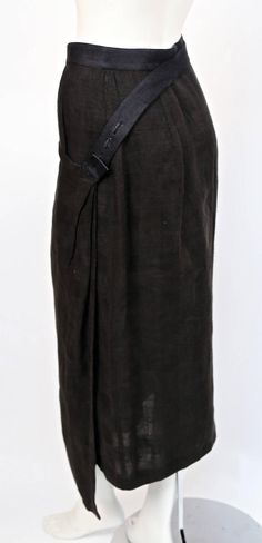 1980's ISSEY MIYAKE draped black linen jacket and skirt with unique straps | From a collection of rare vintage suits, outfits and ensembles at https://www.1stdibs.com/fashion/clothing/suits-outfits-ensembles/