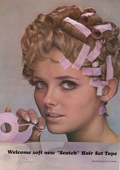 Scotch Hair Tape. My sister used to tape her bangs down overnight so they'd be straight instead of naturally curly.  My Auntie had these ~