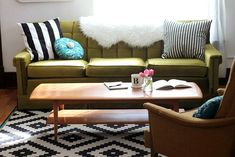 Smile & Wave... olive + bold neutrals + tealy blues with the black and white rug