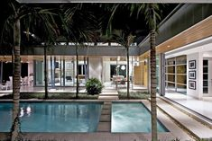 The integration of the pool with both the outdoor and indoor spaces of the house is extraordinary. It's hard to think of the house without the pool. Covered terraces are oriented to the water, and glass walls slide open to connect inside and outside.