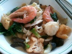 Homemade noodles with seafood in soup
