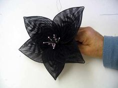 HATalk - Make a flower out of a pair of tights.