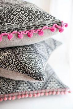 pink and black pom pom pillows