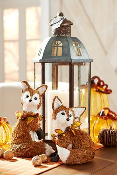 The great thing about red foxes is that they're naturally in autumn colors. Indulge your love of forest critters with these adorable yet curious foxes from Pier 1. One will do, but as a group they add layers of texture to your harvest scene.