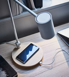 Want a work lamp that blends in with your living room and also fits your home office? Try IKEA RIGGAD; a work lamp and wireless charger in one. The wood and soft design give it a look that's different to most technical products.