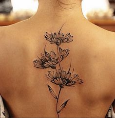 Chen Jie, tattoo artist.  I love these black daisies.  Also, amazing watercolor style tattoos on the site too.