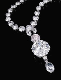 LIGHT PINK DIAMOND AND DIAMOND NECKLACE Estimate: 1,410,000 – 2,350,000  Suspending a detachable Pendant set with two Marquise Diamonds, a Brilliant-cut light Pink Diamond weighing 6.93cts. two circular-cut diamonds, one weighing 34.78cts. and a briolette Diamond weighing 11.38cts., from a graduated Circular-cut Diamond rivière with a step-cut Diamond clasp Accompanied by GIA Report Stating that the 6.93ct.Diamond Is Light Pink Natural Colour VVS1Clarity 34.78ct. Is J in Colour VS1 Clarity