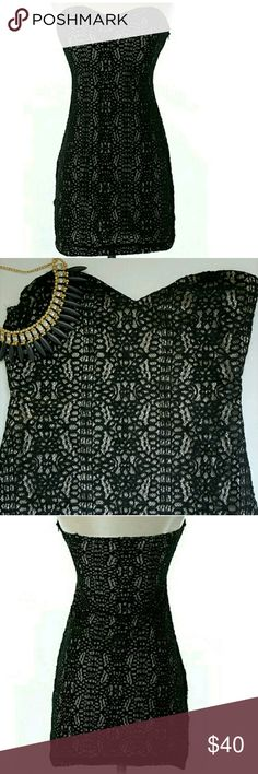 """Urban Outfitters Black Mini Bodycon Dress Sparkle and Fade by Urban Outfitters. Size small. Strapless mini dress with bodycon style fit. Rubber lining on sweetheart neckline to help fit perfectly. Black lace pattern with tan underlay. Zip side closure. Pre-loved, very good condition.  Approximate Measurements laying flat: 26"""" Relaxed Bust, 13"""" Flat Waist (26"""" around), 25.5"""" Length from highest to lowest hemline points. Urban Outfitters Dresses Mini"""