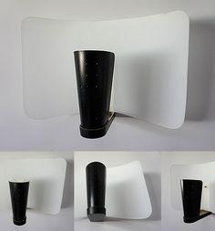 APPLIQUE DISDEROT Applique en métal perforé laqué noir et déflecteur cintré en verre sablé 1955. Edition Atelier Pierre Disderot