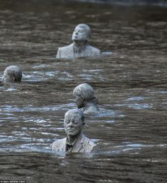 Here they are submerged in the River Thames at high tide