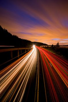 The highway shows movement. Because the road has action on it, with the moving cars and the lights it was taken sped up. Your eyes follow the picture into the distance.