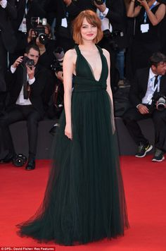 Turning heads! Emma Stone looked flawless when she stepped out for theworld premiere of Birdman at the 71st Venice International Film Festi...