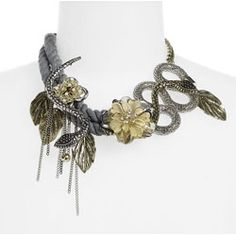 Cleverly composed of serpents with heart-shaped heads, brass leaves, seed pearls, thick silvery-gray rope and more