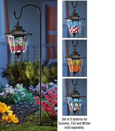 """Seasonal Solar Garden Lantern Seasonal Shade By Collections Etc by Collections. $12.99. Shepherd's Hook with Flower Lantern Shade: Includes shepherd's hook and Springtime flower lantern, plus one rechargeable """"AA"""" battery. Lantern 5""""L x 4 1/4""""W x 6 3/4""""H, Stake 23""""H. Iron/plastic. For set of 3 Seasonal lanterns (sold separately) select """"Seasonal Shade"""" from the drop down box."""