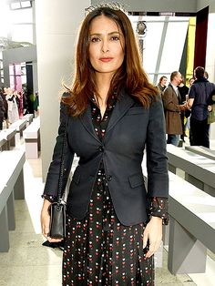 Fashion Week Goes Global: Style Stars Hit Australia, Milan and London | SALMA HAYEK | The actress tops her print dress with a fitted blazer for a look so fall-ready, we have a feeling you'll be wearing a version of it tomorrow.