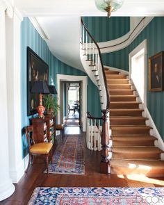 HUDSON VALLEY    Architect Gil Schafer and decorator Miles Redd married classical details and sumptuous colors in the entrance hall of a Hudson Valley, New York, home. The walls were painted by Chris Pearson, and the stair runner is by Stark.