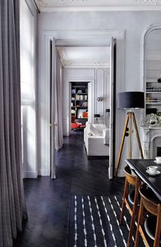 Love dark herringbone, crisp white softened by wood accents.  Color at the end of hall draws me in.  Dark Herringbone Floors // from Everything Fabulous Blog