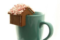 Teeny homemade gingerbread houses that sit on the edge of a mug. Adorable!!