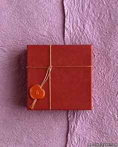 Secure a simple box with a wax seal embellishment