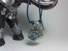 Check out this item in my Etsy shop https://www.etsy.com/listing/209270376/gorgeous-peacock-leather-necklace