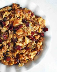Cranberry Apple Sausage Stuffing by Modern Honey. Made with browned butter sauteed onions crisp granny smith apples sausage cranberries and fresh herbs. The perfect classic Thanksgiving side dish recipe. Turkey Stuffing Recipes, Homemade Stuffing, Stuffing Recipes For Thanksgiving, Thanksgiving Side Dishes, Holiday Recipes, Thanksgiving 2020, Christmas Recipes, Christmas Ideas, Sage Sausage
