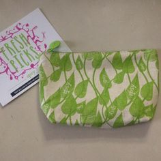 """Green leaf cosmetic bag Super cute make up bag that has a burlap look and feel. Adorable green leaf pattern on one side. Brand new, never used (no actual tags - didn't come with any), and in perfect condition! 7.5"""" x 5.5"""". No trades, no PayPal. ipsy Bags Cosmetic Bags & Cases"""
