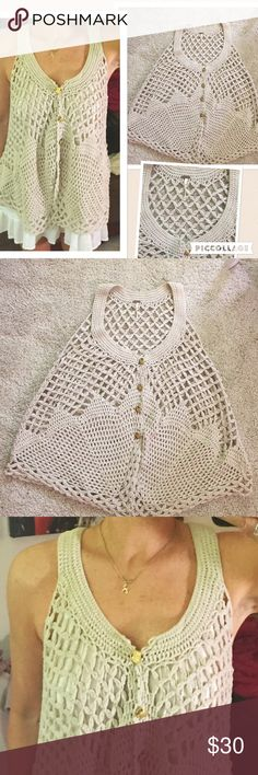 Free People crochet trapeze vest gold buttons Good used condition – Free People crochet vest with trapeze hem and gold buttons. This says size XS but I am a true medium and you can see this is a forgiving style. The only flaw I can find is an area at the back hem where one section of knit has gone unattached. I know that if I could sew I could connect the bits, but I will leave that to you. Priced accordingly. Free People Tops Tank Tops