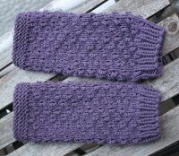 Wrist warmers are all the rage lately.  Knit your own using this free knitting pattern for  Hot Pepper Wrist Warmers that are a lovely shade of purple.