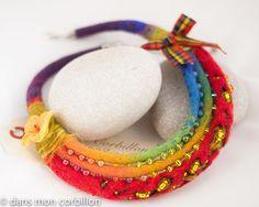 by Dans mon corbillon. Felt, fabric, fibers, beads & flower