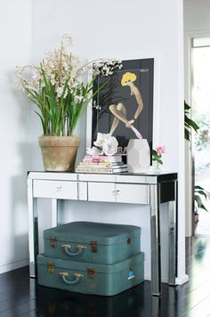 A gorgeous mirrored console table adds sparkle to this corner -  Adore mag
