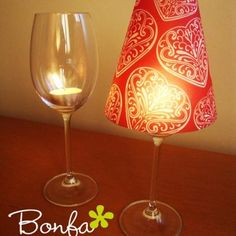 How to turn a wine glass into a candle lamp. Easy and cheap way to dress up a table for a party.