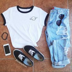 7. White T with washed out blue ripped jeans, classic Vans, and black shades